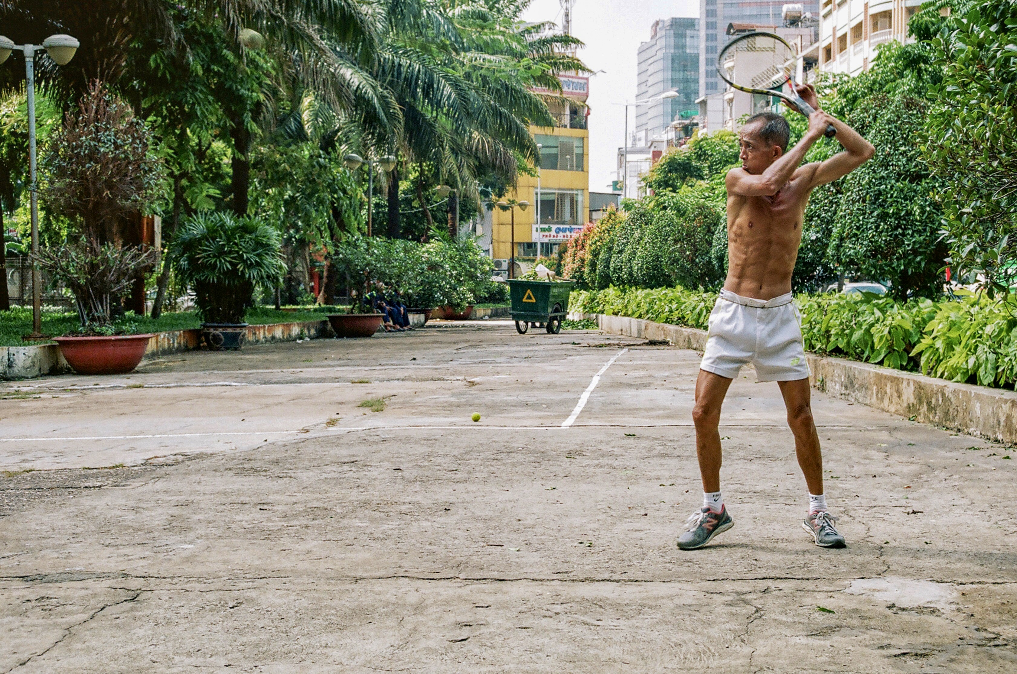 Man About to Strike Using Tennis Racket