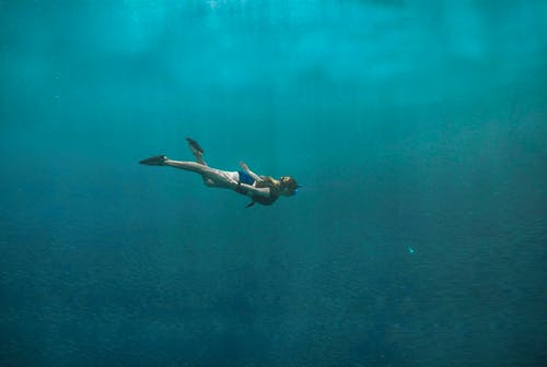 Photo of Woman Swimming Underwater