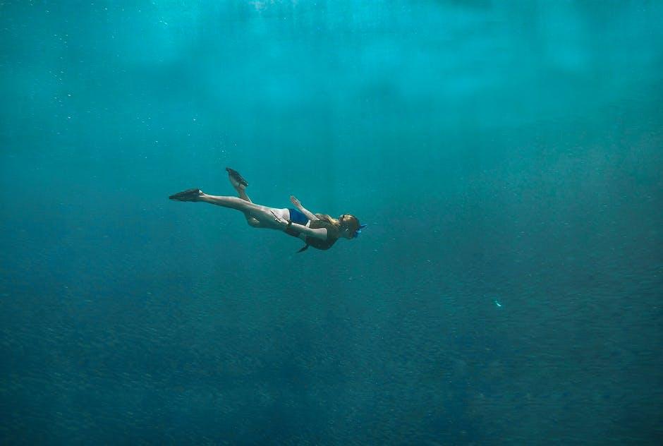 Photo of woman swimming underwater