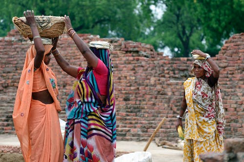 Photo of Woman Carrying Basket