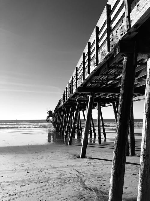Grayscale Photography of Wooden Seadock