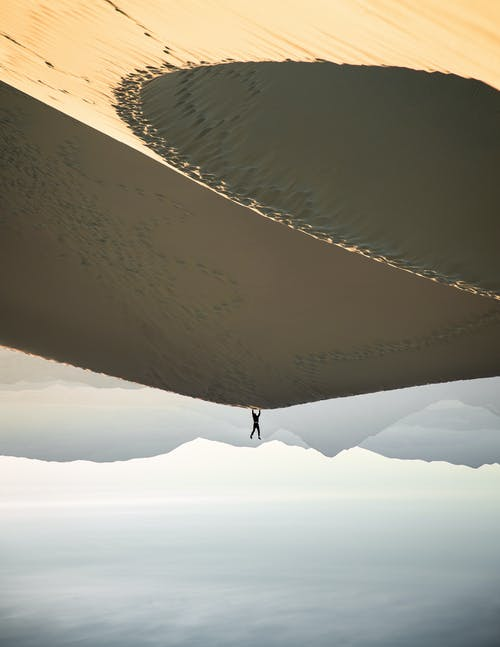 Photo of Man Doing Handstand on Desert