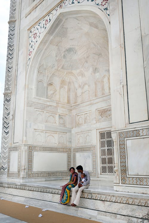 Couple Sitting on Marble Surface