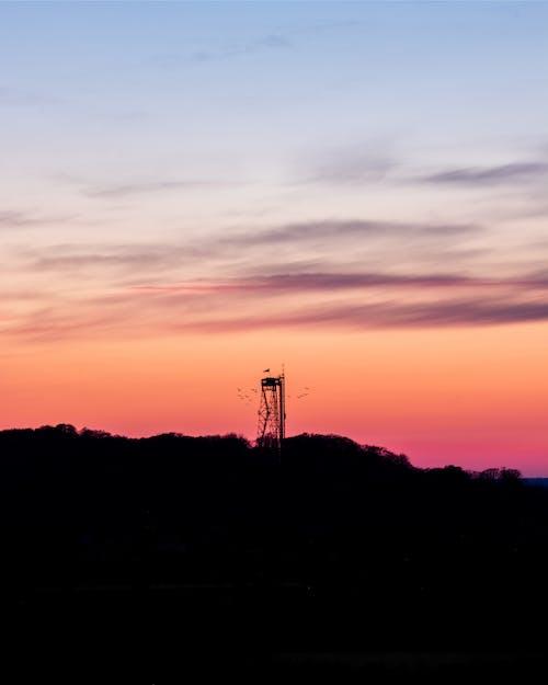 Foto stok gratis menara aalborg saat matahari terbenam