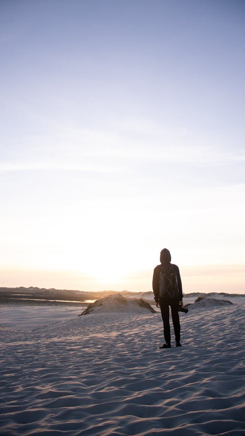 Free stock photo of Guy standing in sand dunes