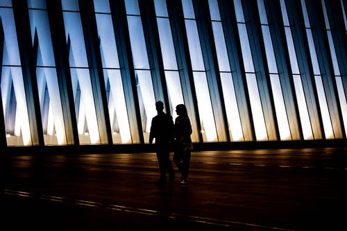 Silhouette Photography of Man and Woman Walking