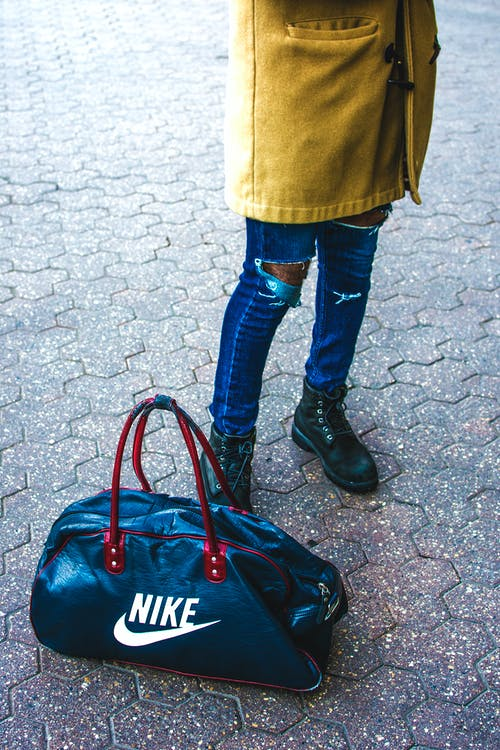 Gratis stockfoto met fashion, fotografie, nike, stijl