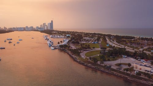 Aerial Photography of City Near the Body of Water during Golden Hour