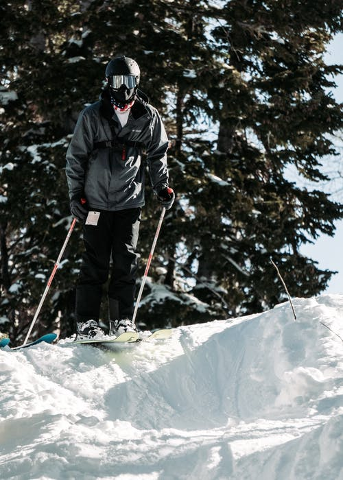 Photo of Man Skiing Downhill