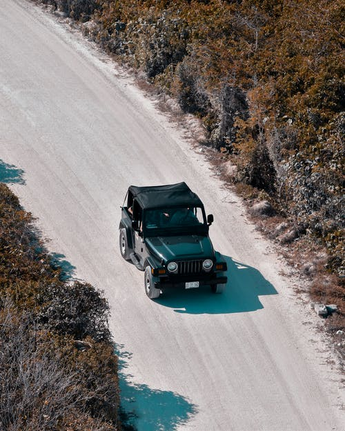 Aerial Photography of Black Jeep SUV on Road