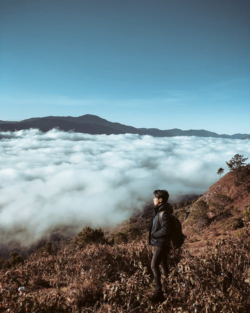 Photo of Man Standing Near Clouds