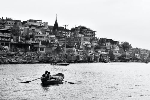 Monochrome Photography of Two Persons Riding Boat