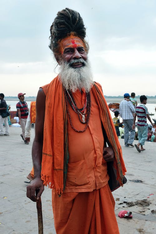 Man Wearing Turban and Orange Clothes