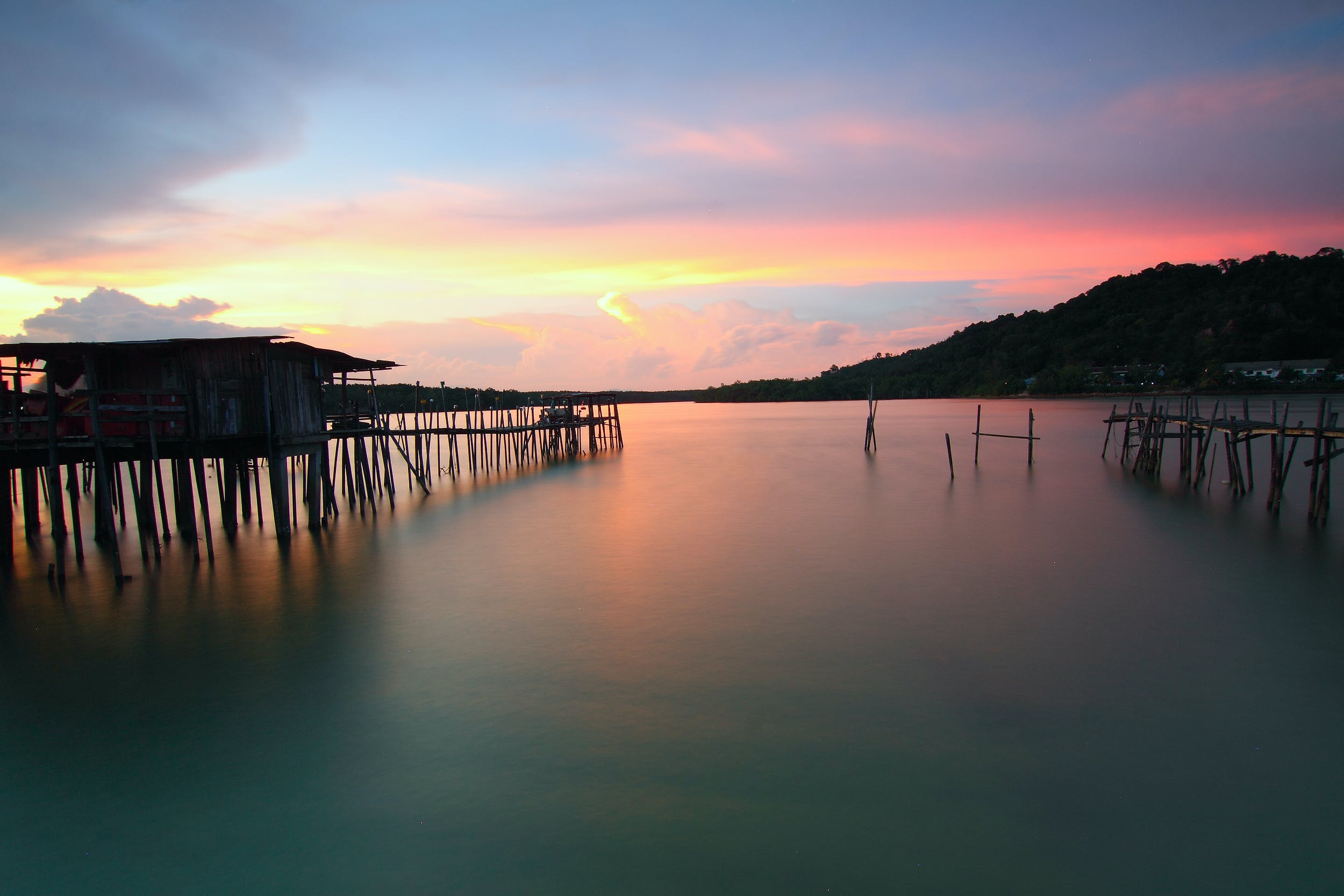 Brown Wooden Dock and Sea during Sunset