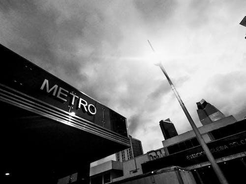Monochrome Photography of Metro Signage