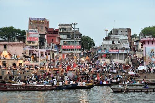 People Riding on Boat on River