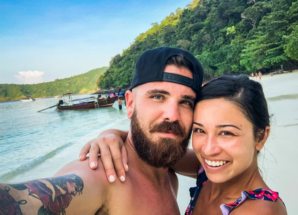 Man Wearing Black Snapback Cap Taking Selfie Beside Woman Smiling