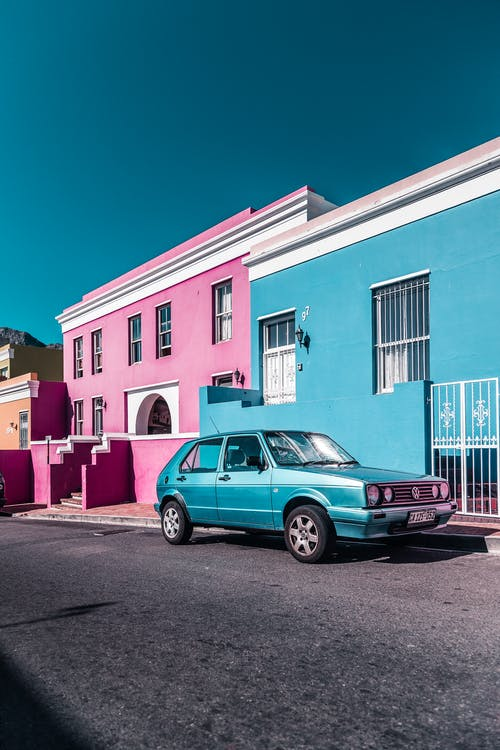 Parked Blue Car Beside Building
