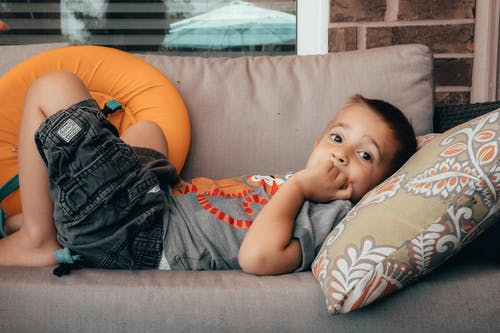 Photo of Boy Lying on Sofa