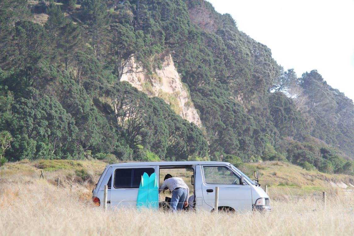 Person Bending Forward Inside Van