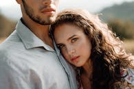 Close-up Photo of Woman Leaning on Man's Chest