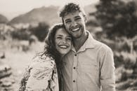 Grayscale Photography of Smiling Couple