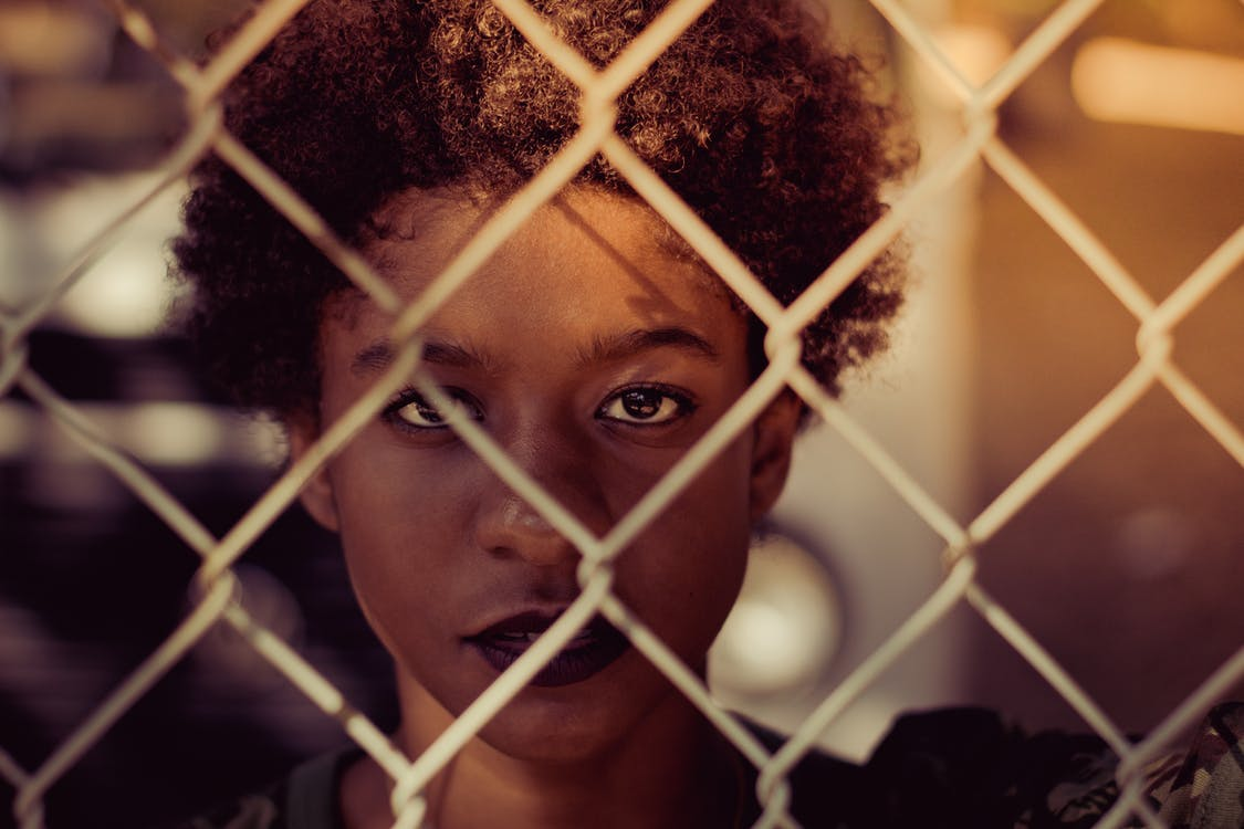 Woman Standing Beside White Chain-link Fence