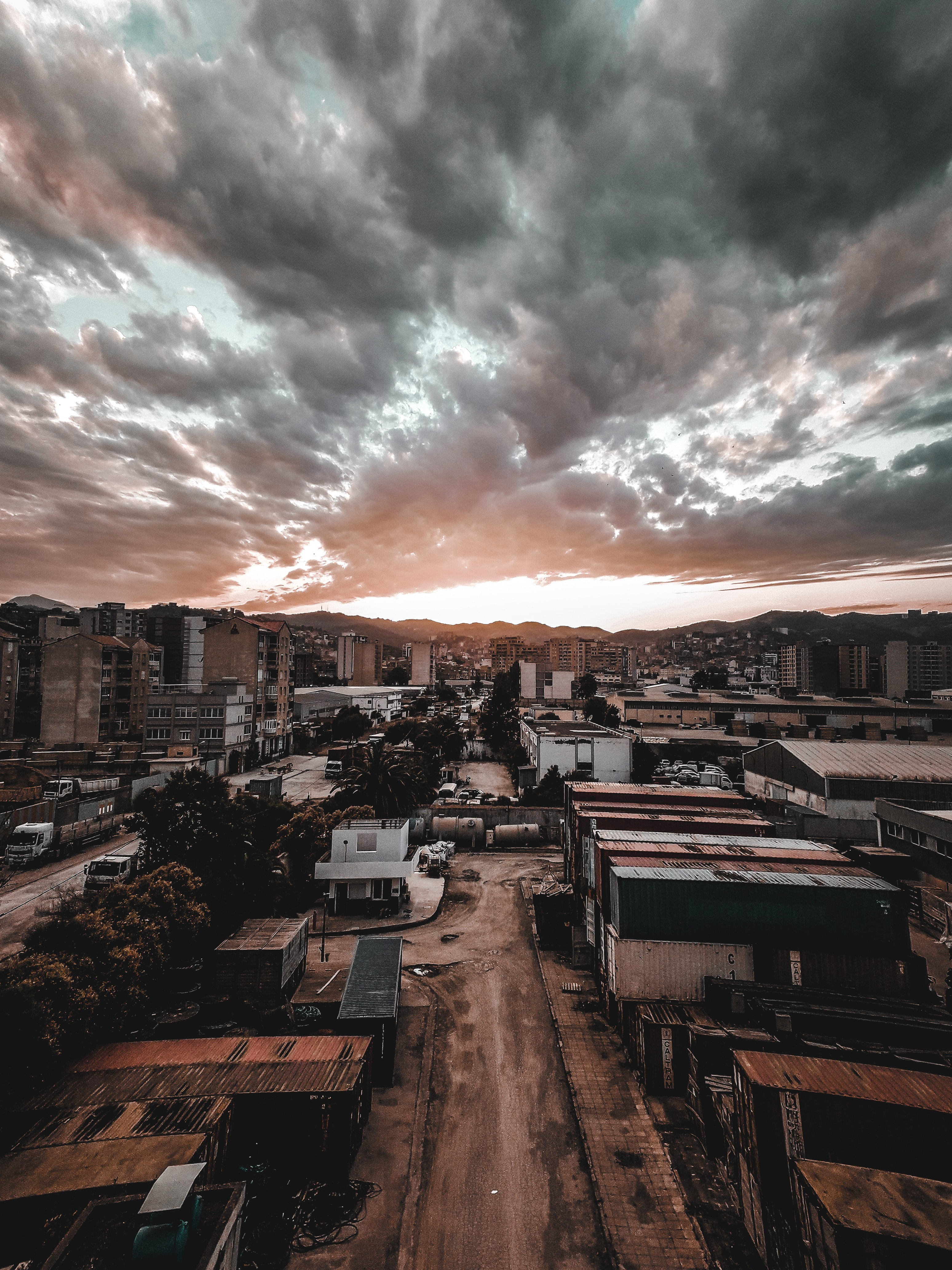 Aerial Photography If Cityscape Under Dramatic Sky · Free