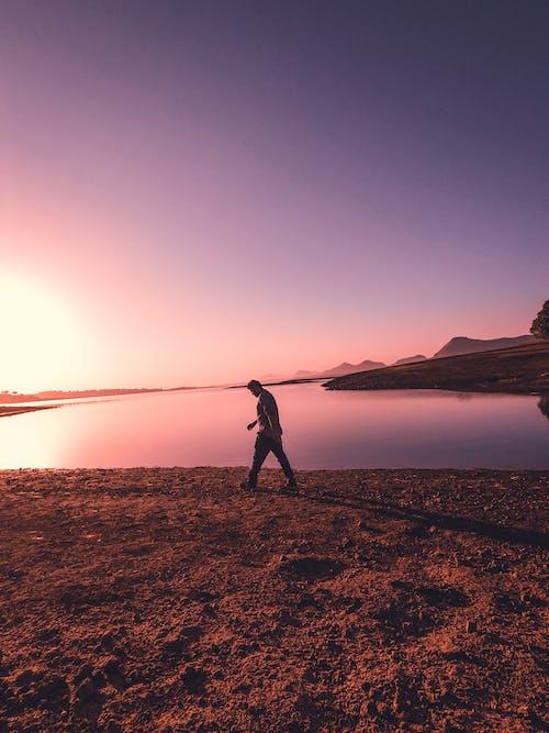 Person walking near a water body