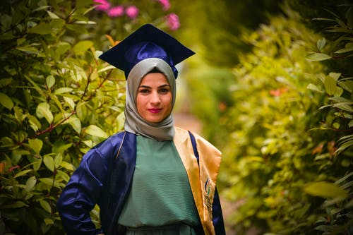 Woman Wearing Academic Dress and Mortar Board