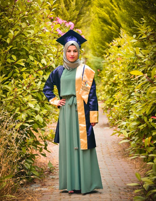 Woman Wearing Academic Dress and Mortarboard
