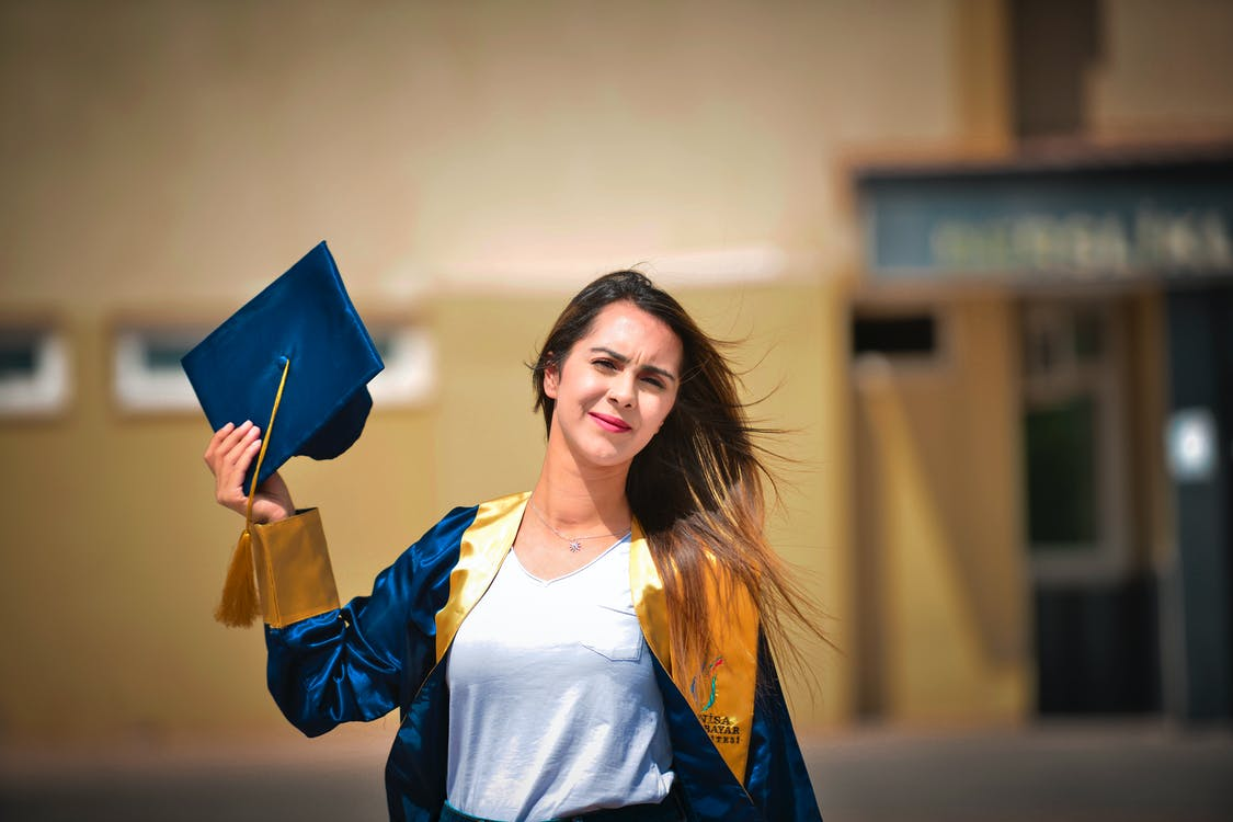 Woman Wearing a Blue and Yellow Graduation Toga