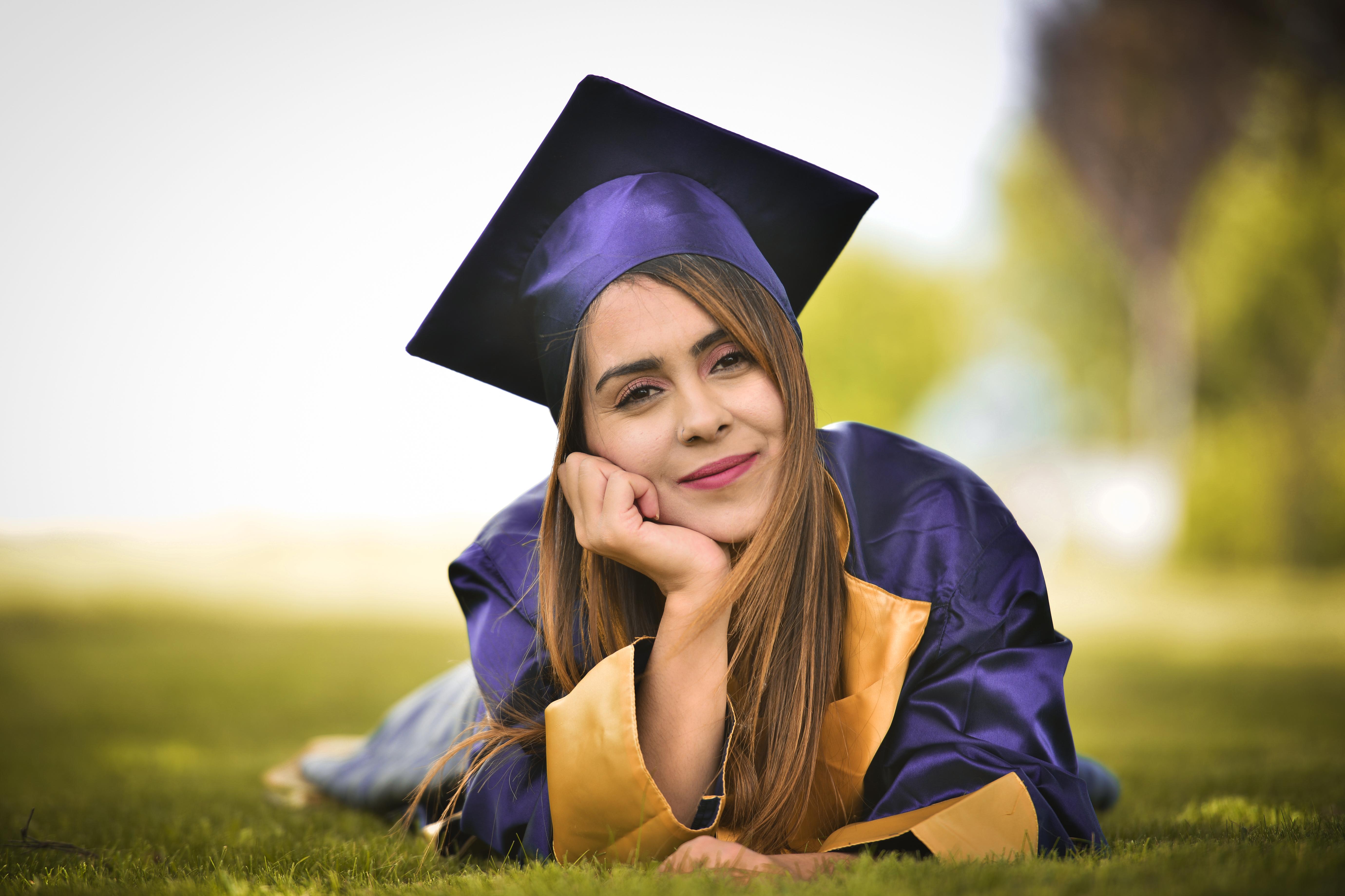 Graduate lying on grass