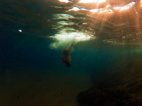 Person Swimming Underwater