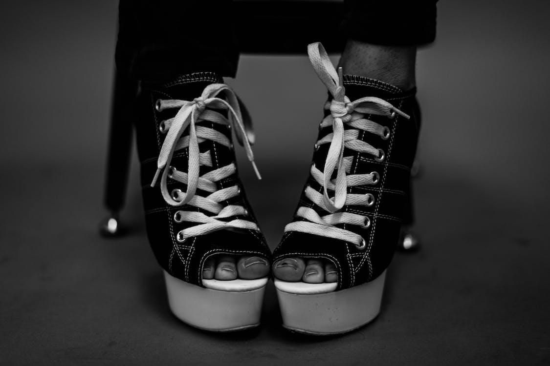 Person Wearing Black Leather Peep-toe Wedge Booties