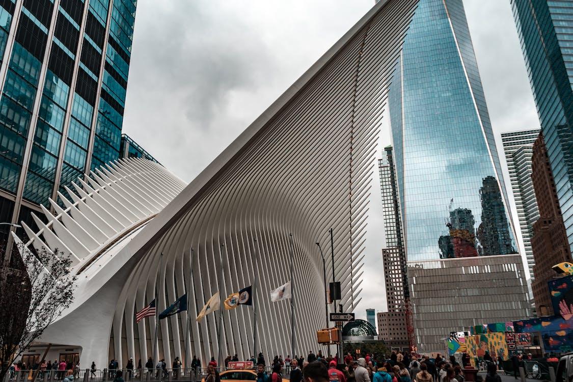 Photo of People Walking Near Buildings