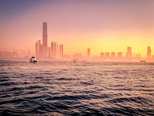 Základová fotografie zdarma na téma hoření, město, mrakodrapy, oranžová obloha