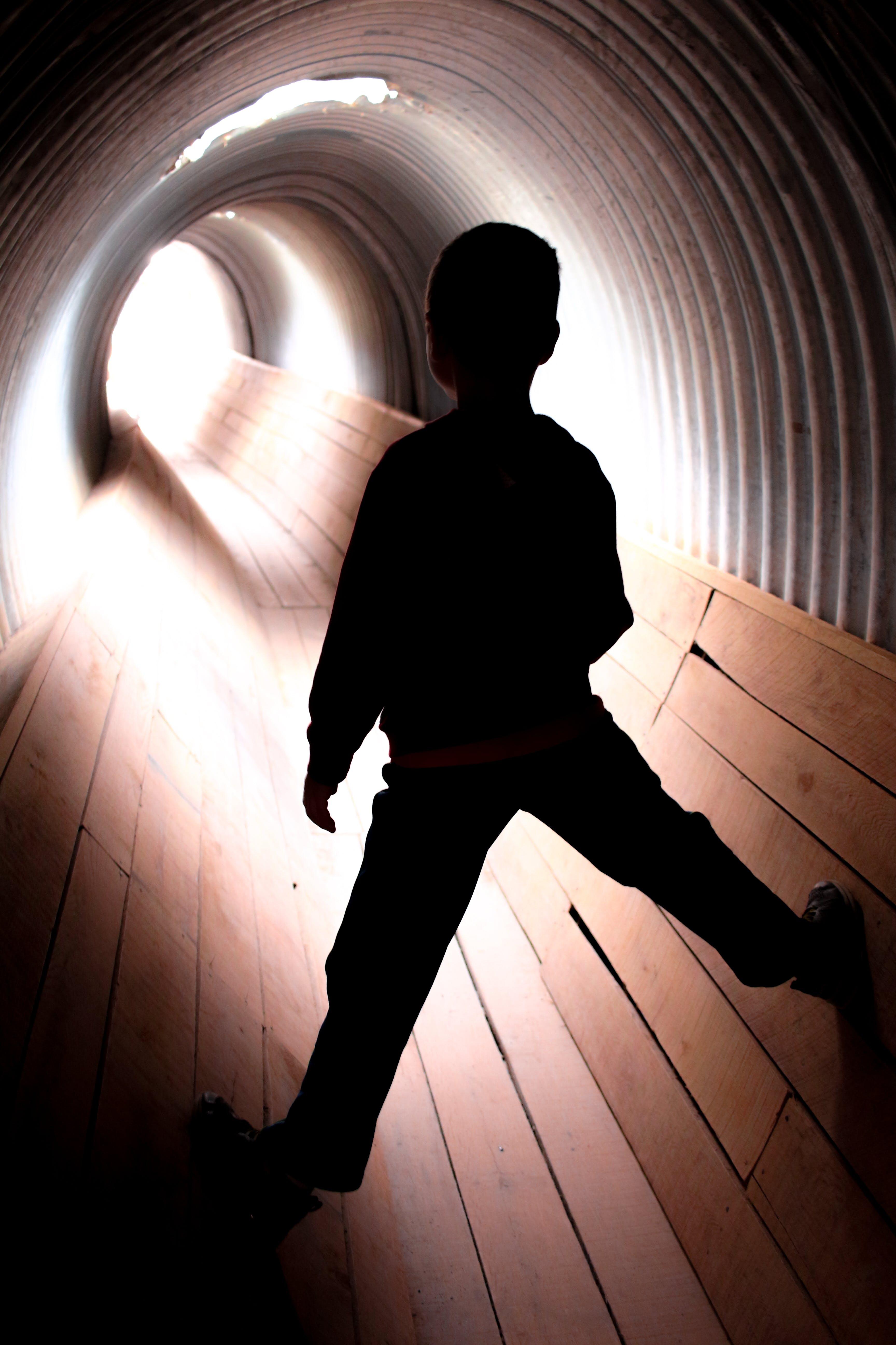 Free stock photo of child, climbing, light, tunnel
