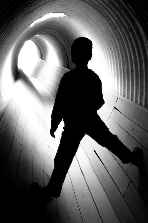 Free stock photo of black and white, boy, child, climbing