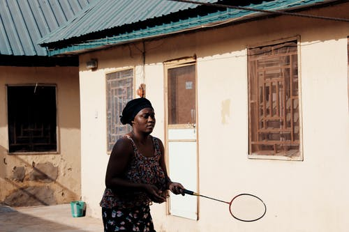 Woman Holding Badminton Racket