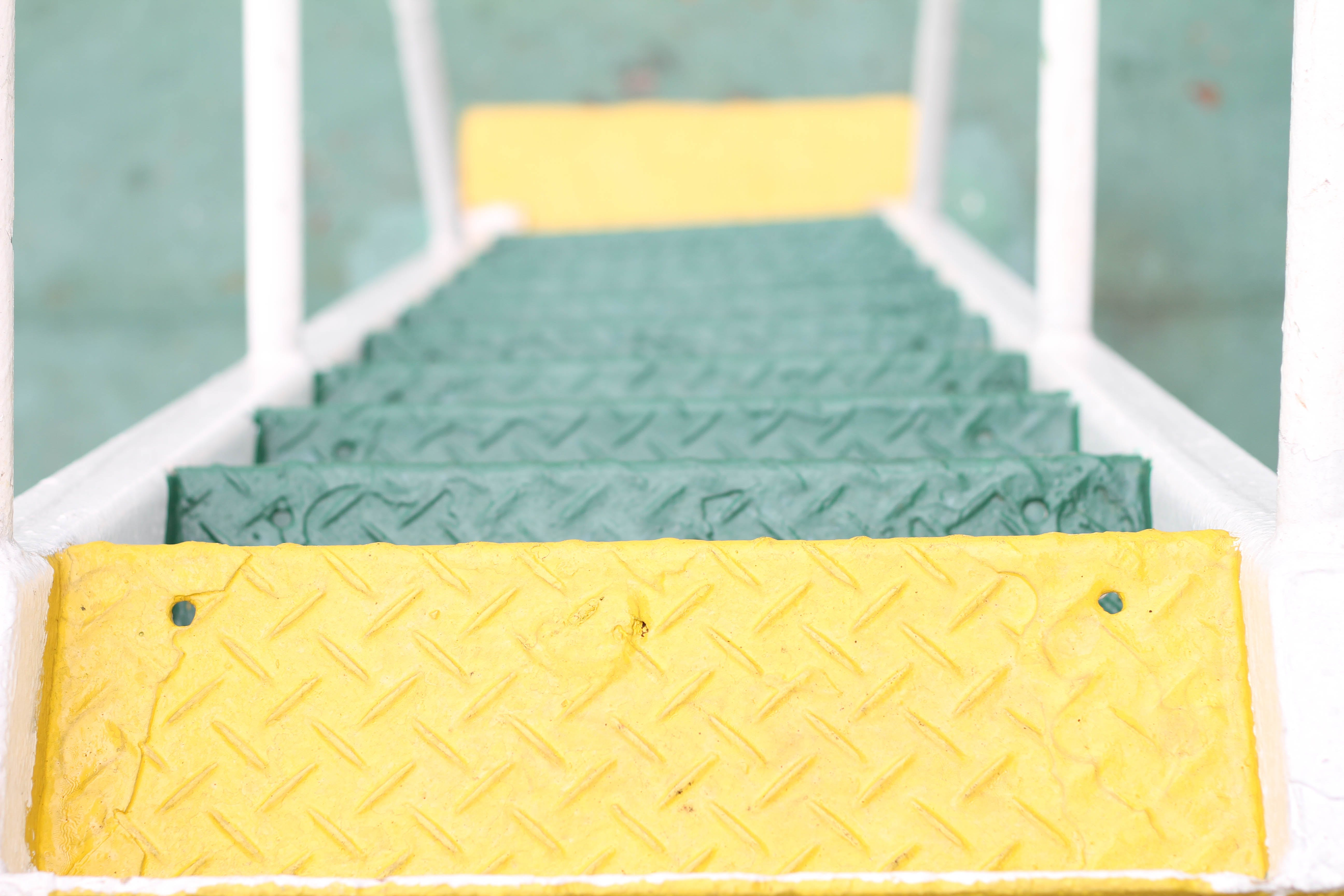 Green and Yellow Metal Diamond-plated Ladder High-angle Photography