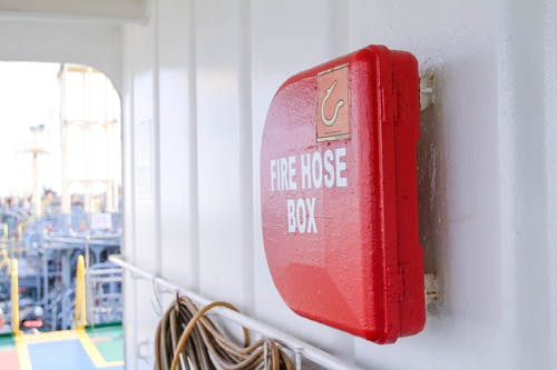 Red Fire Hose Box on Focus Photo