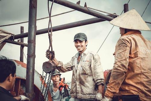 Ilmainen kuvapankkikuva tunnisteilla hymy, joukkue, meri, tankkeri