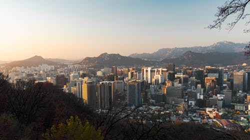 Urban Area Surrounded By Mountain Range