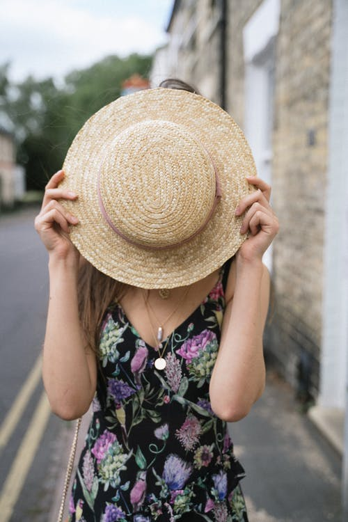 Woman Covering Face With Sunhat
