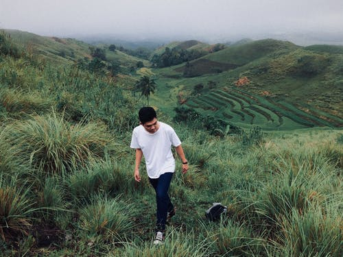 Man Walking on Rice Terraces