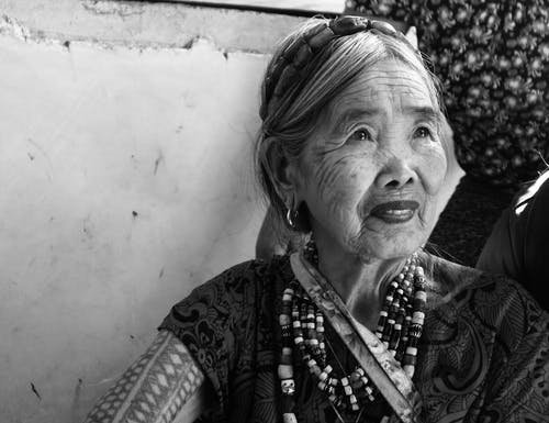 Grayscale Portrait Photo of Old Smiling Woman