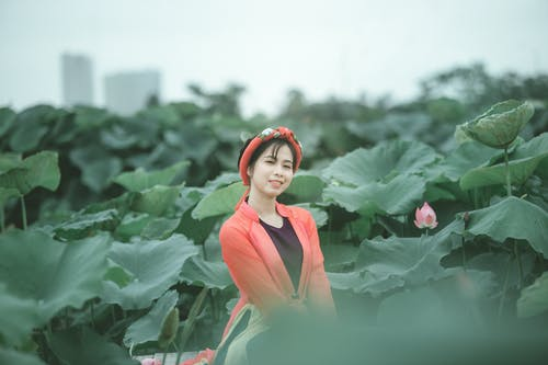 Smiling Woman In The Middle Of Plant Field