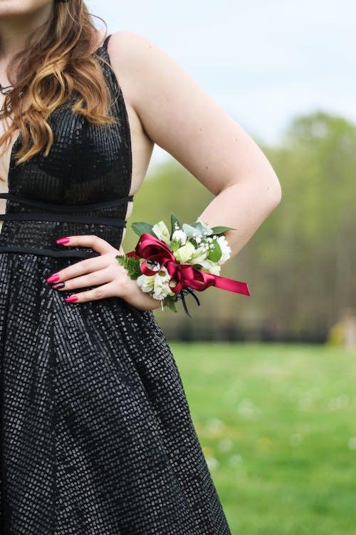 Woman Wearing Black Dress And Flower Bracelet