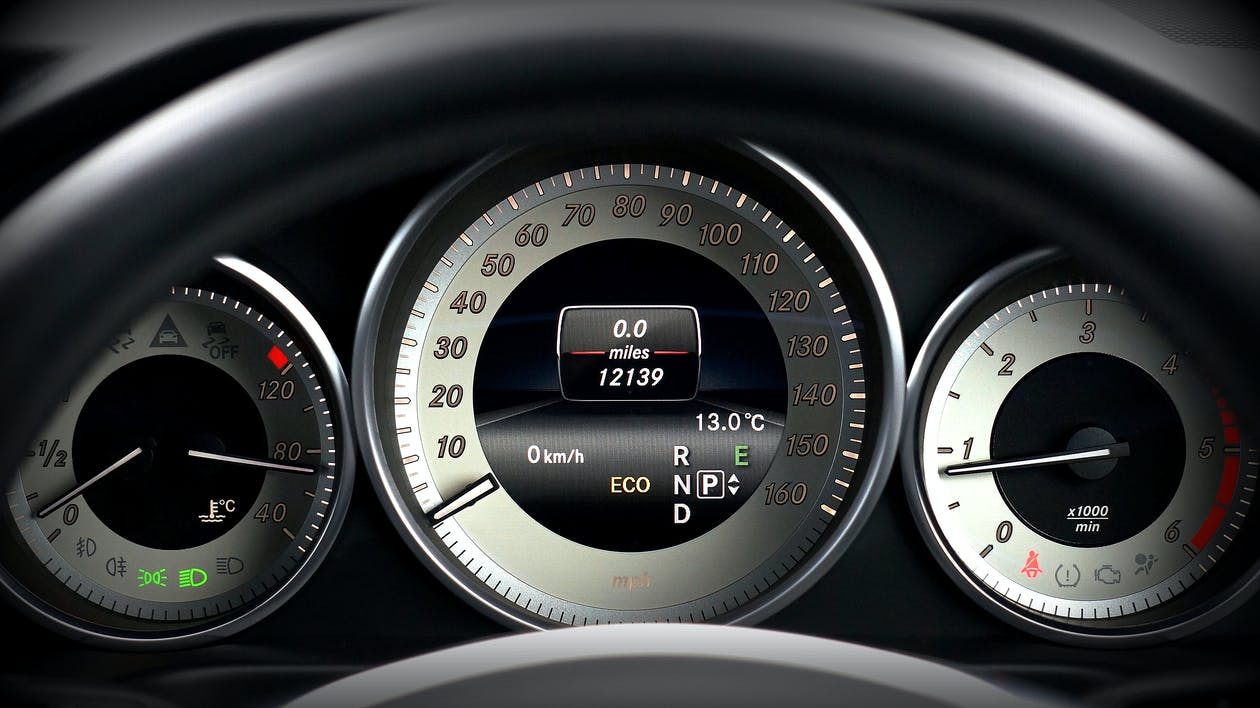 Black and Gray Vehicle Analog Instrument Cluster Panel
